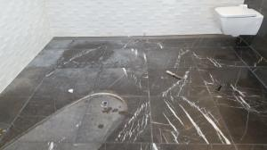 Marble bathroom before a full restoration
